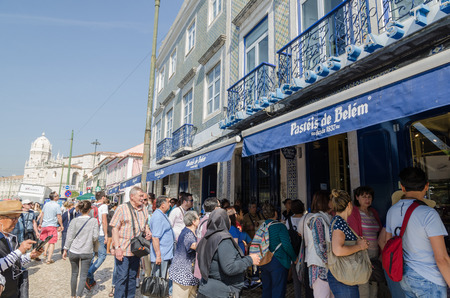 Tourists in line in front of the famous cafe Pasteis de Belem in Lisbon, Portugal