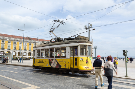 Lisbon, Portugal - April 25, 2017: Traditional yellow tram at Praca do Comercio, the famous square in Lisbon Editorial
