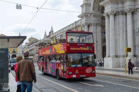 Lisbon, Portugal - April 25, 2017: Hop on Hop off bus at Praca do Comercio in Lisbon, Portugal Editorial