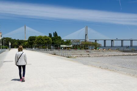 Lisbon, Portugal - April 27, 2017: Walking towards the Vasco da Gama Bridge in Lisbon, Portugal Editorial