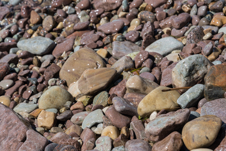Background picture of wet pebbles by the coast Stock Photo