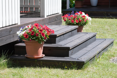 Flowerpot decorations on wooden stairs in a garden Stock Photo