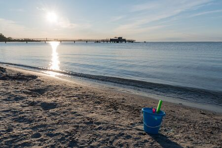 Evening by a sand beach with bath pier and toys at the swedish island Oland