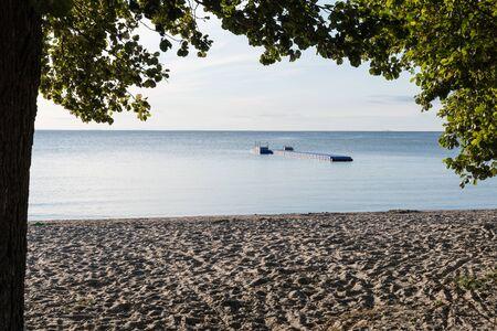 Beach with a floating bath pontoon at the swedish island Oland