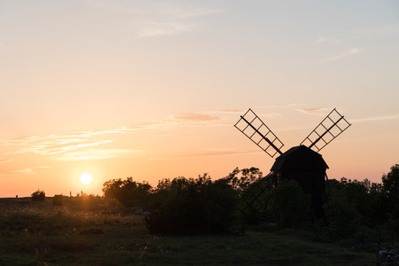 Colorful sunset by an old wooden windmill at the swedish island Oland Stock Photo