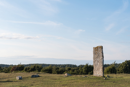 Standing stone in a swedish world heritage at the southern part of the island Oland Stock Photo