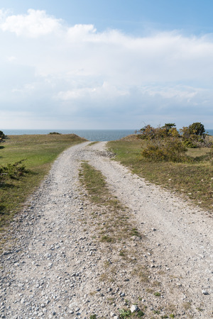 Old gravelroad towards the coast at the swedish island Oland in the Baltic Sea Stock Photo