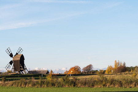 Old wooden windmill in a fall season colored landscape at the swedish island Oland