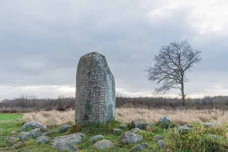 Ancient runestone in a landscape at the swedish island Oland in the Baltic Sea