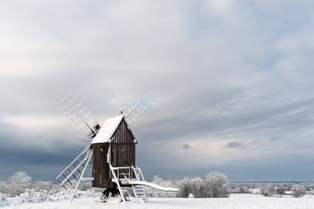 Old windmill in a snowy landscape at the island Oland in Sweden