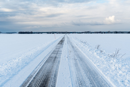 Straight road in a wintry landscape at the swedish island Oland Stock Photo