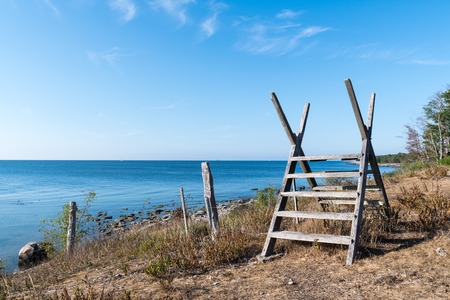 Old wooden stile by seaside at the swedish island Oland in the Baltic Sea Stock Photo