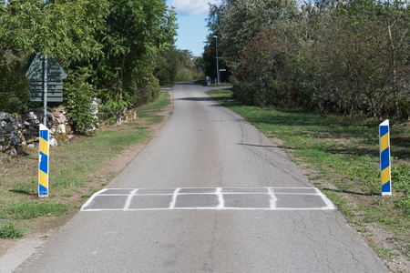 Speed limitation by a road bump on a country road