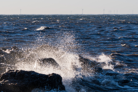 Stormy weather with splashing water by the coast of the swedish island Oland