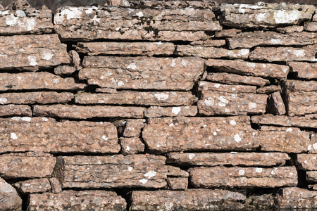 Background of an old limestone brickwall, a tradional fence at the swedish island Oland Stock Photo
