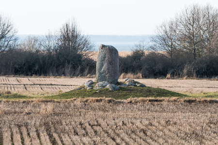 Standing rune stone by Karlevi at the Swedish island Oland in the Baltic Sea