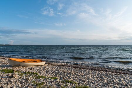 Colorful rowing boat landed on the beach at the swedish island Oland 写真素材 - 131984116