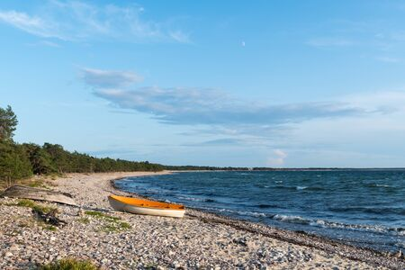 Landed colorful rowing boat in a bay with blue water at the island Oland in Sweden 写真素材 - 131983285
