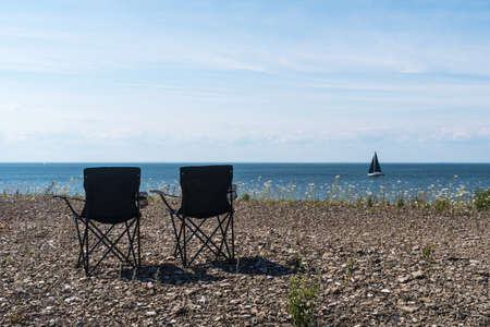 Summer view with two chairs by the coast Stock Photo