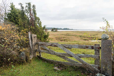 Weathered old wooden gate by the coast of the Baltic Sea on the island Oland in Sweden