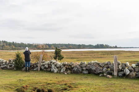 Bird watcher in fall season on the swedish island Oland