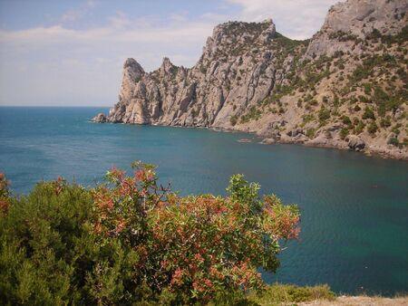 Beautiful Dragon Mountain and summer peaceful sea photo