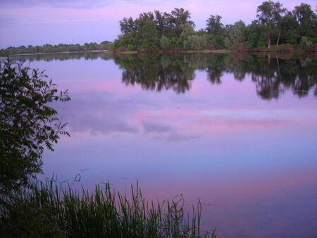 beautiful calm sunset at summer peaceful river photo