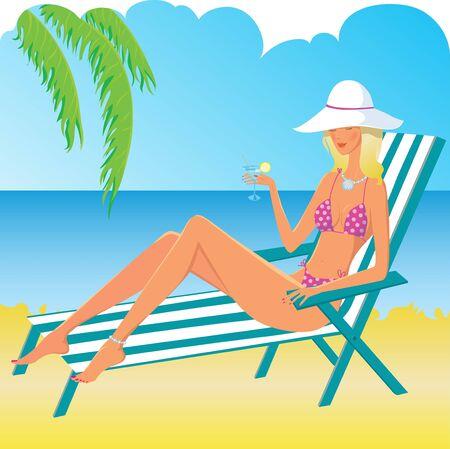Hermosa niña rubia relajante en la playa