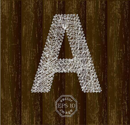 attach: Letra A, hecha con hilos de las patillas