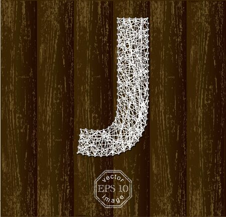 threads: Letter J, made with threads on pins on wooden background. Part of collection.