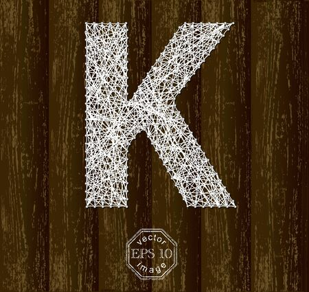 background part: Letter K, made with threads on pins on wooden background. Part of collection.