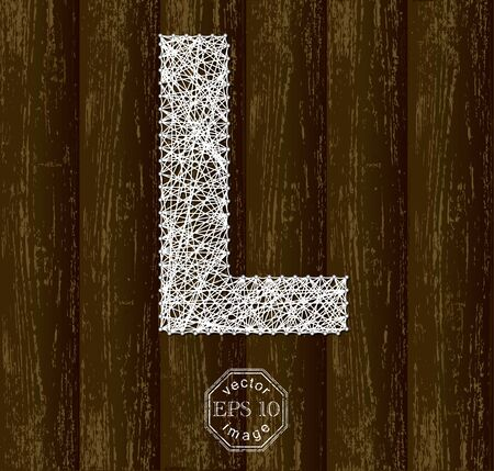 threads: Letter L, made with threads on pins on wooden background. Part of collection.