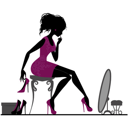 showroom: Silhouette of elegant girl in show-room trying on shoes