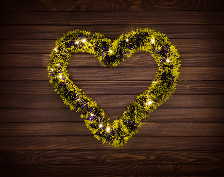 Shiny garland decoration in shape of heart Imagens