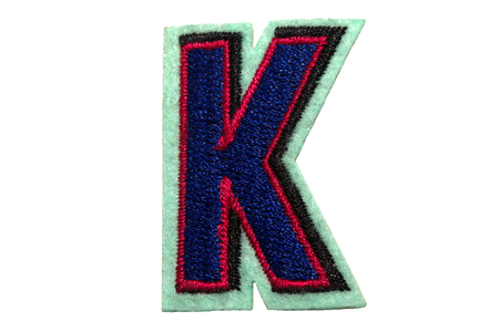 Letter K made from felt on the white isolated