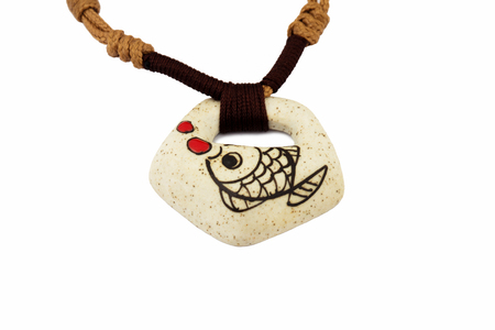 isolated stone necklace fish Imagens