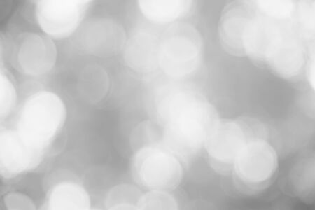 White and gray abstract background bokeh from natural. christmas blurred beautiful from nature. Stock fotó