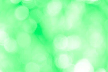 Grüner Bokeh-Texturhintergrund von natürlichem