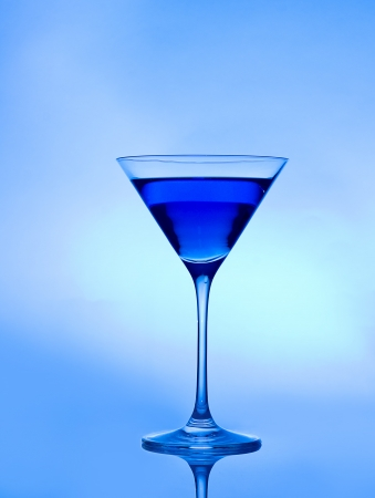 blue drink  on a blue background in a cocktail or martini glass Stock fotó