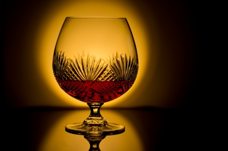 Brandy snifter backlit with low light