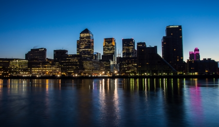 docklands: The Docklands development by night in london england Stock Photo
