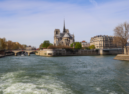 Notre Dame Cathedral over Seine river in spring. Before the fire. April 05, 2019. Paris France