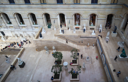 Paris  France - April 04 2019. Ancient sculptures in the inner hall of Louvre museum