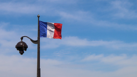 A French flag on a lamppost in Paris France. April 2019 Reklamní fotografie - 122284613