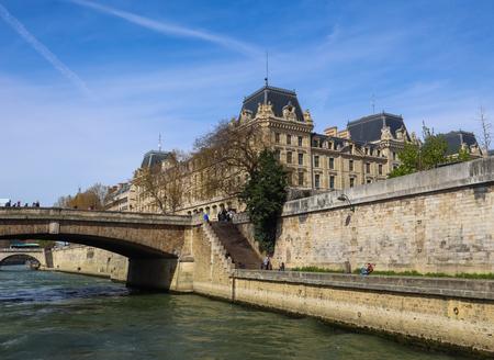 Paris  France - April 06 2019: Bridge across Seine River and beautiful historic buildings of Paris Redakční