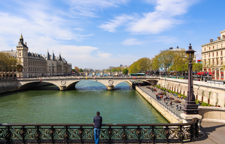 Paris  France - April 06 2019: Beautiful cityscape of Paris and Saint-Michel bridge across Seine river