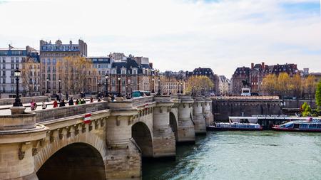 Paris  France - April 05 2019: Bridge Pont Neuf across Seine River and  beautiful historic buildings of Paris Redakční