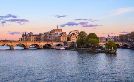 The oldest bridge ( Pont Neuf ) across Seine River and historic buildings of Paris France at sunset. April 2019