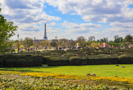 Paris / France - April 04 2019: In wonderful Tuileries garden of Louvre in spring. View on Eiffel tower