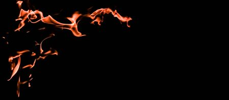 Flames of fire on a black background. The mystery of fire. 写真素材